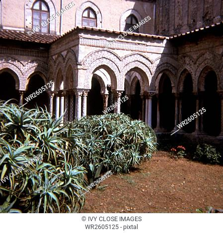 This slide, taken within the cloister area of Monreale, the Benedictine Cloister, in Palermo dates to 1970. The cloister dates to c. 1200 A