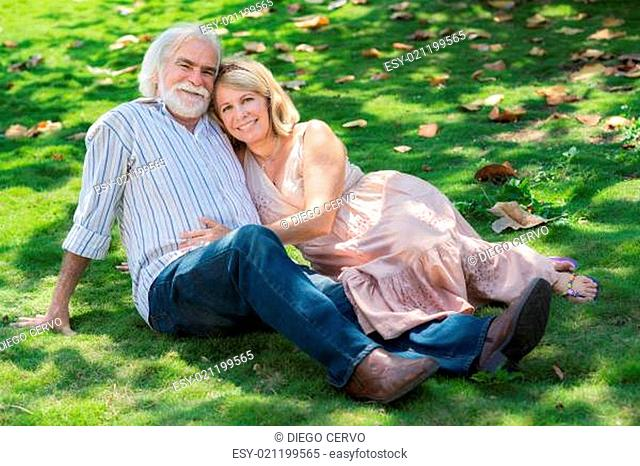 Senior people in love with man and woman hugging