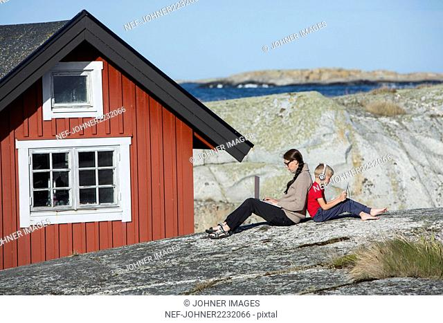 Mother with son relaxing at coast