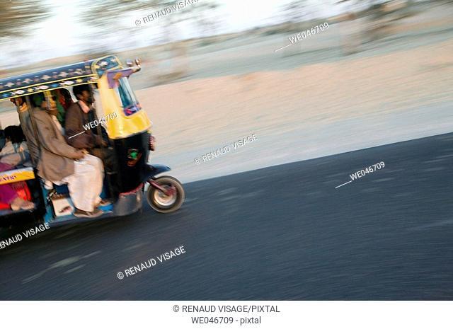 Speeding rickshaw. Bikaner. Rajasthan. India