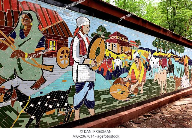 INDIA, NAGPUR, 17.06.2010, Tile work depicting village scenes at the Gowari Memorial in memory of the Gowaris who perished during a stampede