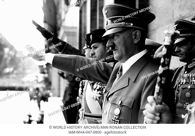 Adolf Hitler and Count Ciano salute on a chancellory balcony in Berlin. Hitler was chancellor of Germany from 1933 to 1945 and dictator of Nazi Germany from...