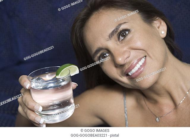 Woman raising her glass in toast