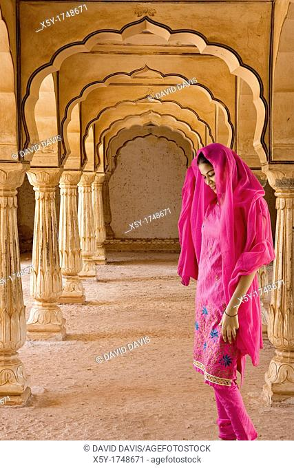 Colorful Hindu woman at Amber Fort temple in Rajasthan Jaipur India