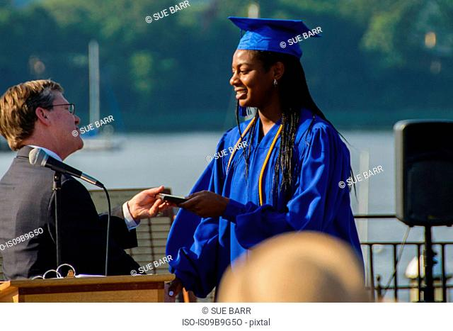 Teenage girl at her graduation ceremony