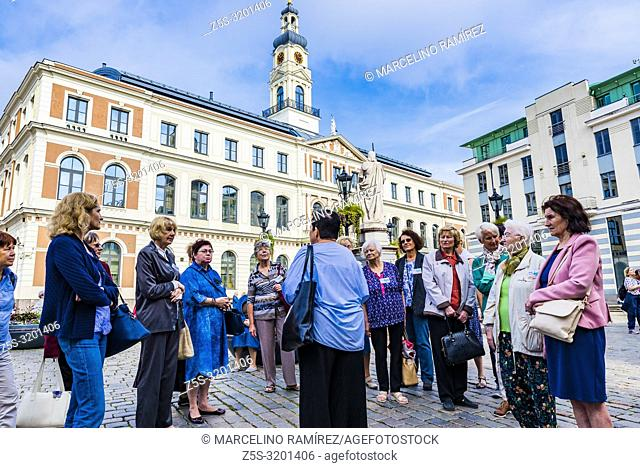 Group of tourists. Riga City Council is the government of Riga City, the capital of Latvia. It is located in the Riga Town Hall at the Town Hall Square, Riga