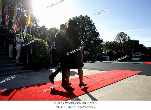 U.S. President Barack Obama and first Lady Michelle Obama walk out to welcome Pope Francis prior to his arrival ceremony at the White House on September 23