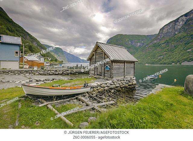 landing stages and boat houses at the seashore, village Undredal at the Aurlandsfjorden, Norway, municipality of Aurland, Sognefjorden, Sogn og Fjordane county