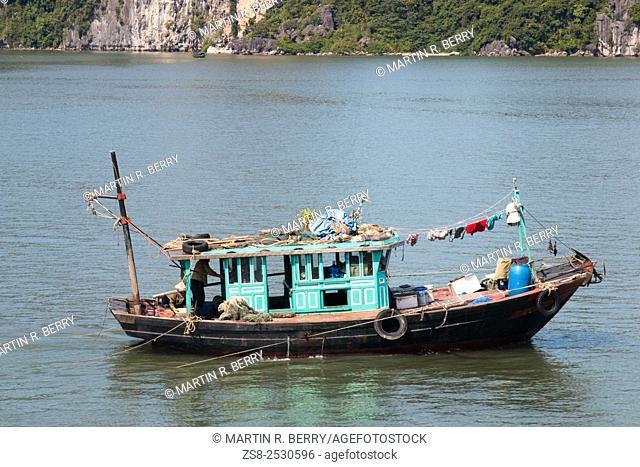 Fishermans boat in Halong Bay, Unesco world heritage area, Vietnam