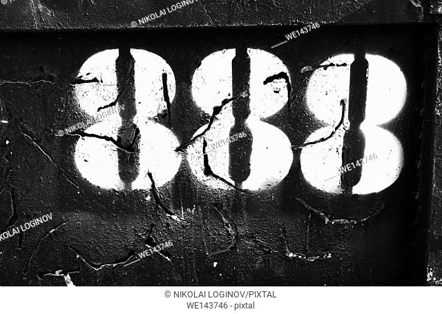 Horizontal cyberpunk number 888 on rusty container backdrop