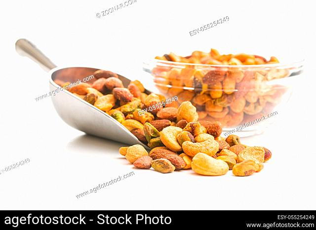 Spicy flavoured nuts. Mix of nuts in scoop isolated on white background