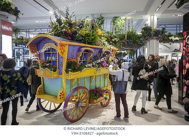 Macy's flagship department store in Herald Square in New York is festooned with floral arrangements for the 44th annual Macy's Flower Show