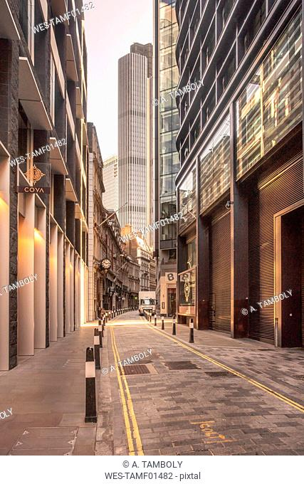 UK, London, narrow street in the City of London financial district with skyscrapers in the background