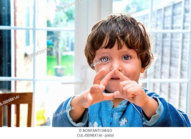 Toddler boy making shapes with his fingers