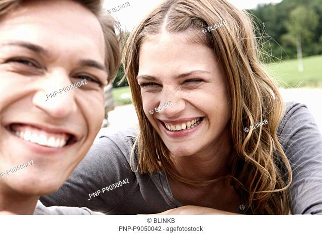 Young couple smiling a lot