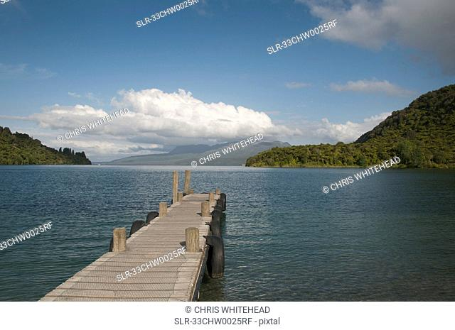 Wooden jetty over lake