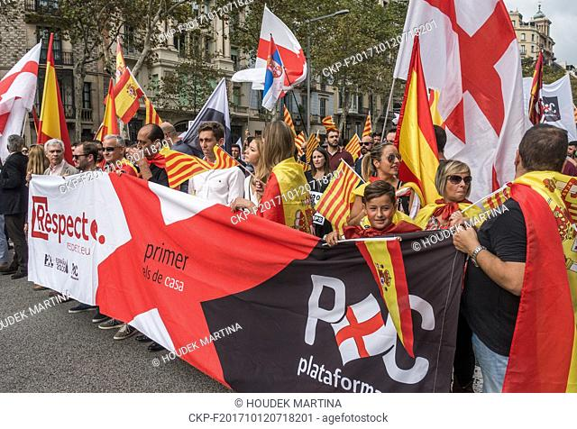 Demonstrators of Plataforma x Catalunya waving Spanish flags and Catalan Flags during the protest against Catalonia independence movement in Barcelona, Spain