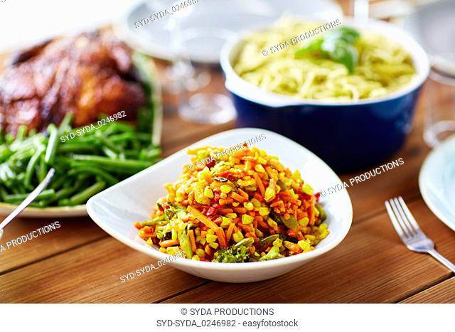 vegetable salad with corn and other food on table