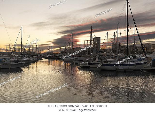 Alicante, Spain. February 9, 2018: Views of the Port of Alicante during a sunset in winter