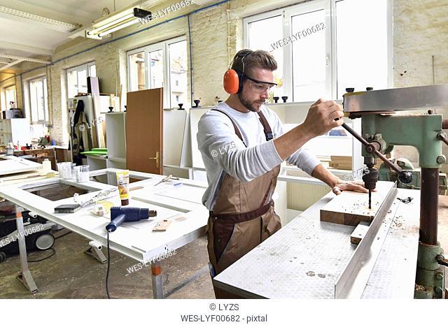 Carpenter at work in his workshop
