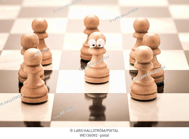 Chess piece with eyes. Conceptual image of childhood and stress. Bullying and being left out