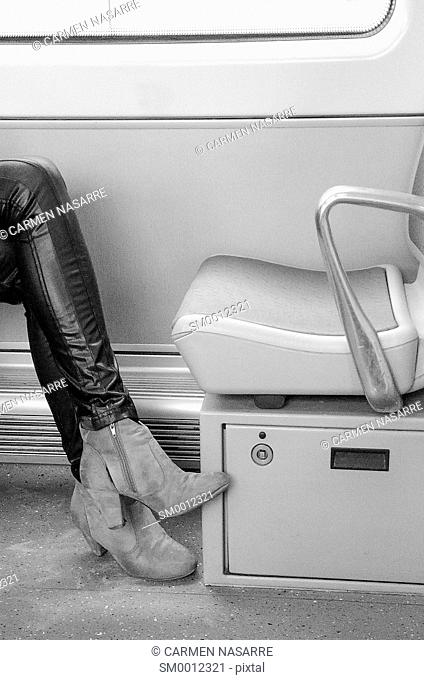 Woman with leather pants and empty seat