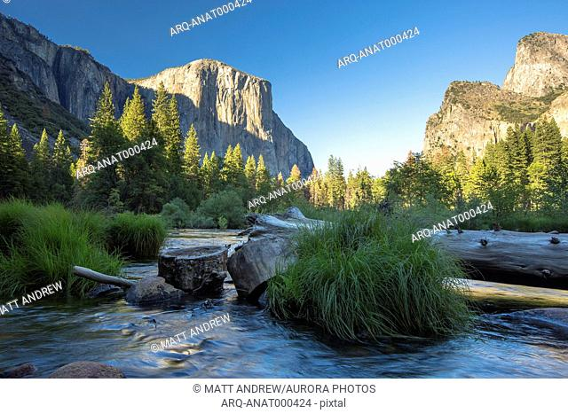 El Capitan, Cathedral Rocks, and the Merced River in Yosemite National Park glow at sunset