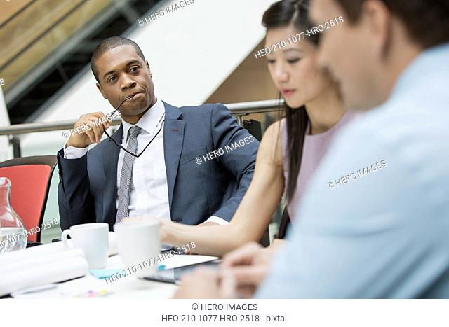 Serious businessman listening attentively in meeting