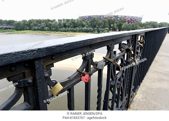 Locks that are attached to bridges as 'lovelocks' according to custom hang near the national stadium on the banks of the Vistula River in Warsaw, Poland