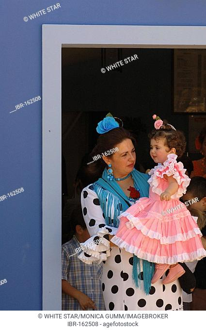 Woman with child in traje de gitana , Feria de Caballo , Jerez de la Frontera , Cadiz , Andalusia , Spain , Europe