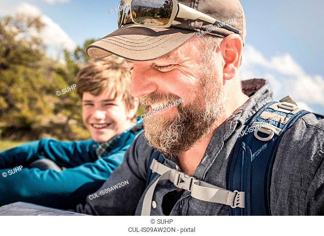 Close up of father and teenage son on hiking trip, Cody, Wyoming, USA