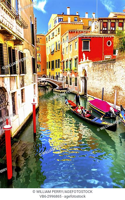 Gondola Tourists Colorful Small Canal Bridge Buildings Boats Reflections Venice Italy