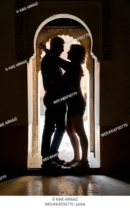 Morocco, Marrakesh, couple hugging in doorframe