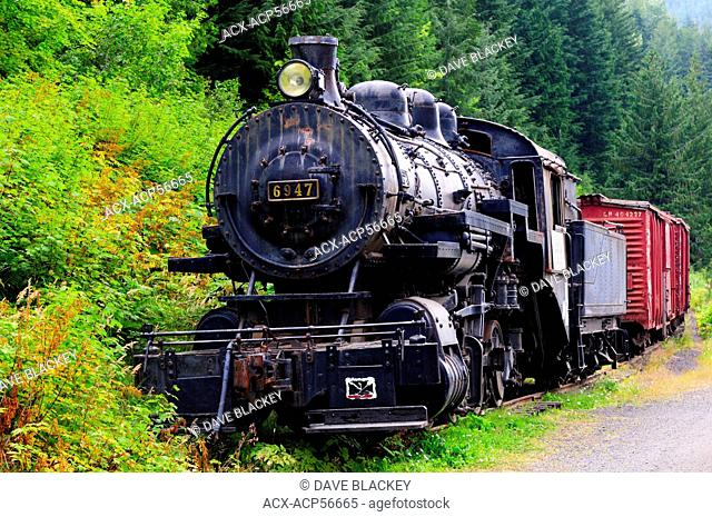 Canadian Pacific Rail's old steam locomotive 6947 and vintage freight train in the ghost town, Sandon, BC