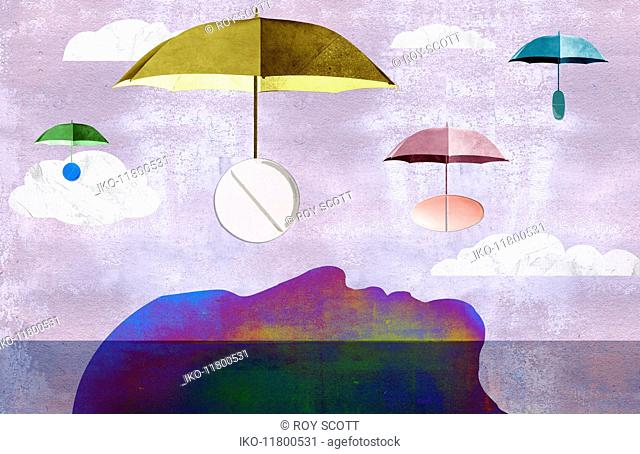 Pills on umbrellas floating down to man lying down
