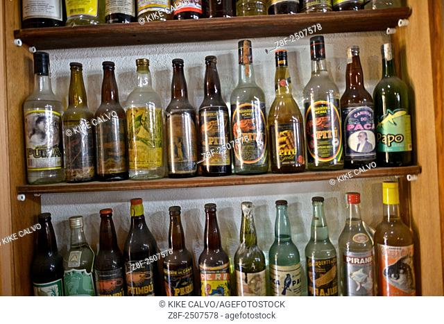 "Vintage alcoholic drink bottles inside a liquor store called """"Emporio da Cachaça"""" in Paraty"