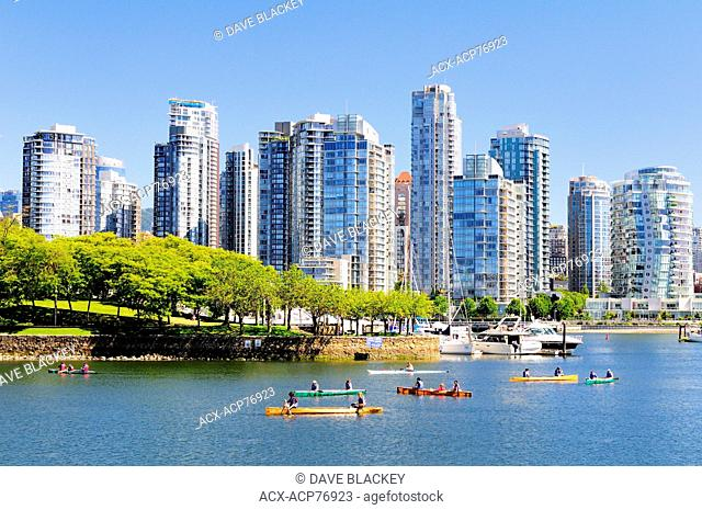 People canoeing near Ron Basford Park in False Creek in Vancouver, BC