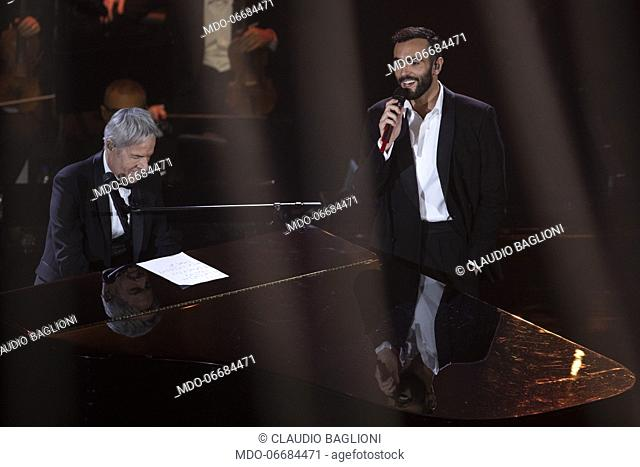 Italian singer Marco Mengoni and Italian singer and presenter Claudio Baglioni during the second evening of the 69th Sanremo Music Festival