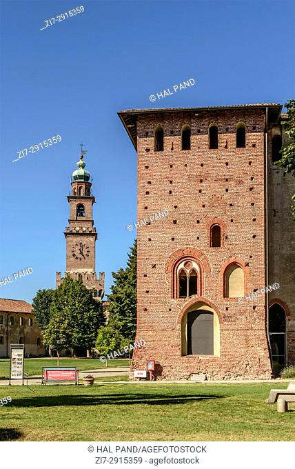 view of courtyard main building and of historical Bramante tower in Renaissance castle of small town, shot in a bright summer day at Vigevano, Pavia, Lombardy