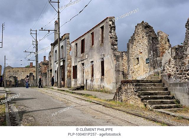 Ruins along the high street. The burned village Oradour-sur-Glane was destroyed on 10 June 1944, when 642 of its inhabitants, including women and children