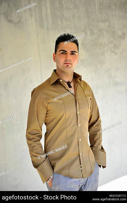 Young, confident man, casually dressed, wearing a shirt
