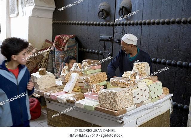 Morocco, Middle Atlas, Fez, Imperial City, Fez El Bali, medina listed as World Heritage by UNESCO, detail of a stand of nougat and candy in the Ruelle...