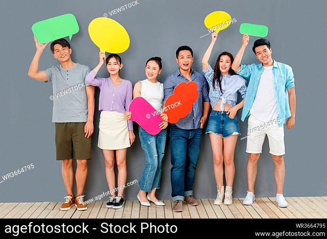 In the happy young people with a dialog box