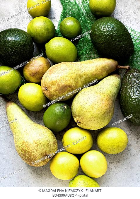 Overhead view of yellow and green colour fruits