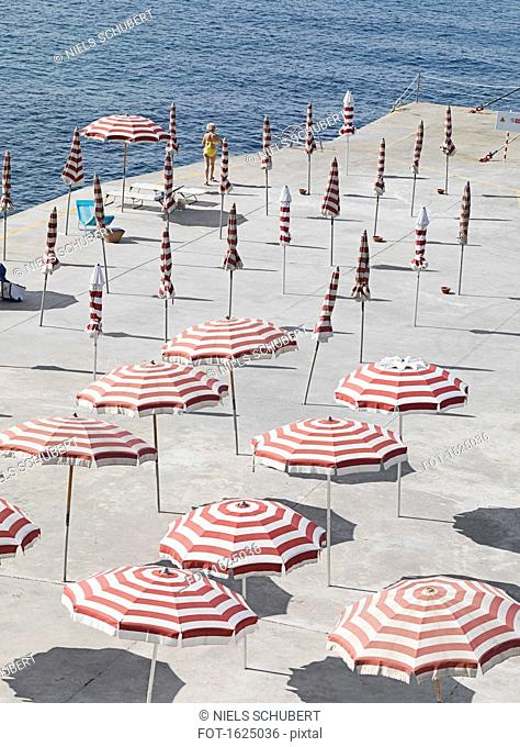High angle view of striped parasols at beach