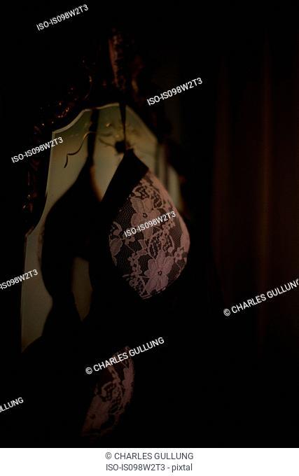 Lace bra hanging on mirror