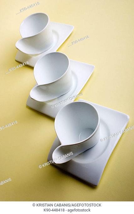 Three white coffee cups in futuristic design