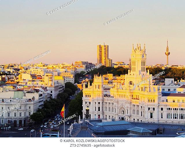Spain, Madrid, Elevated view of the Cybele Palace at sunset