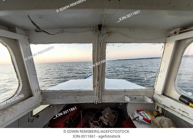 View out of the front window of boat on the Chesapeake Bay in the early morning, Dundalk, Maryland. USA