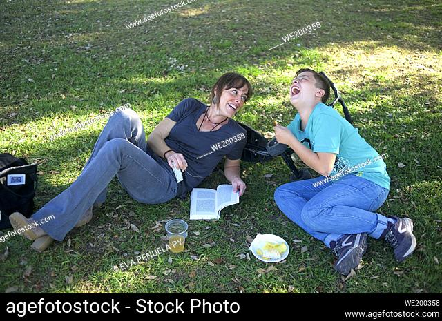 Mother and son having a picnic on the grass